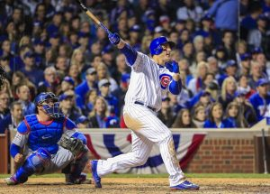 Chicago Cubs first baseman Anthony Rizzo (R) hits a solo home run off Los Angeles Dodgers